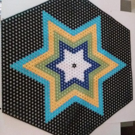 Multiple colour beaded star design in black background.