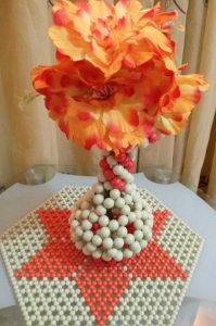 Flower beaded vase on beaded mat