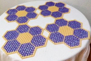 Table decor with purple and cream golden beaded mat