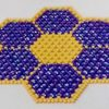 Purple and Golden creams beaded star design table mat