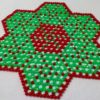 Red and green beaded star design tablemat